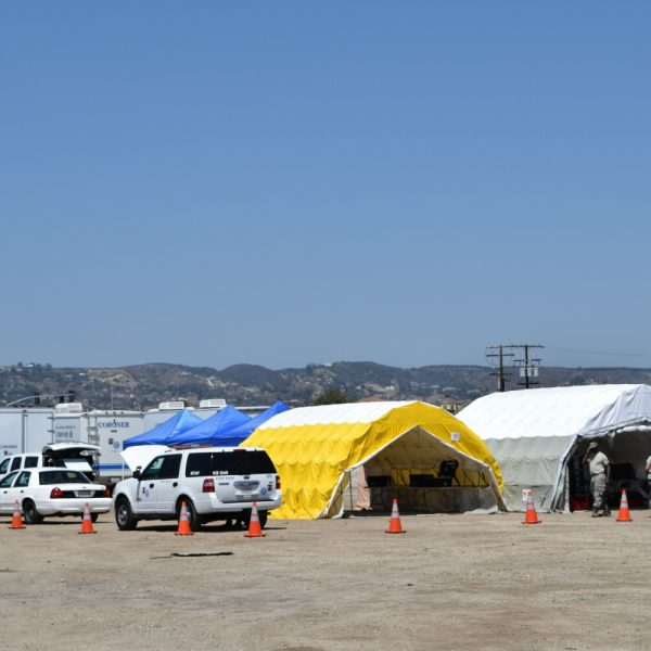Forensic tents and police vehicles